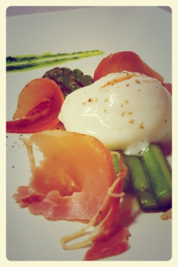 Sous vide egg and asparagus with prosciutto and basil oil